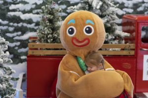 Gingerbread Man Hugging Small Female Child