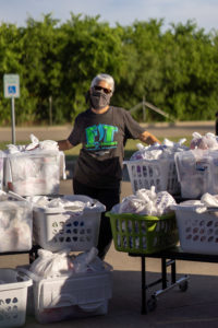 Junior League of Austin Member Volunteers at a FIT Summer Distribution Day