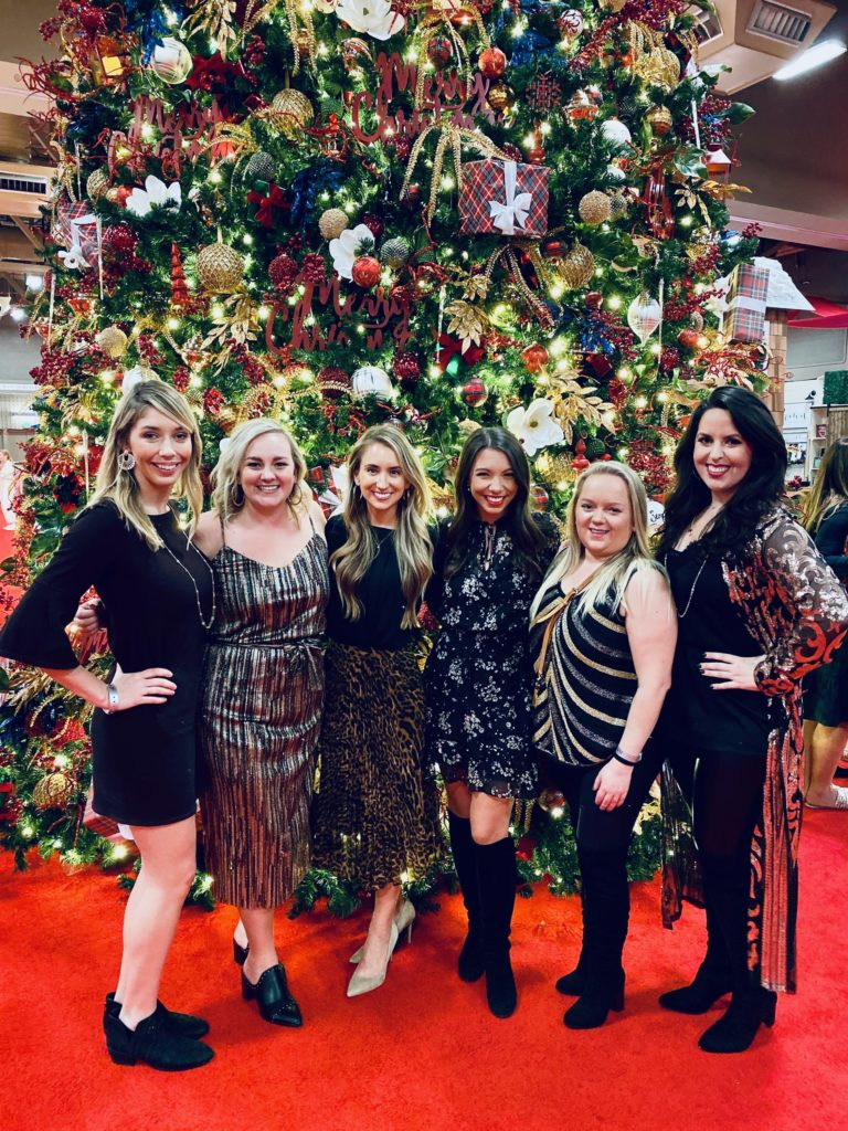 Junior League Friends Posing for Photo in Front of Christmas Tree at A Christmas Affair